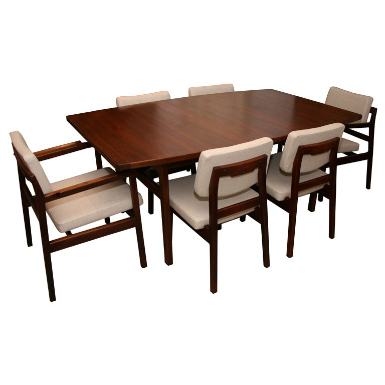 this jens risom walnut dining table with 2 leaves and 6 chairs is no