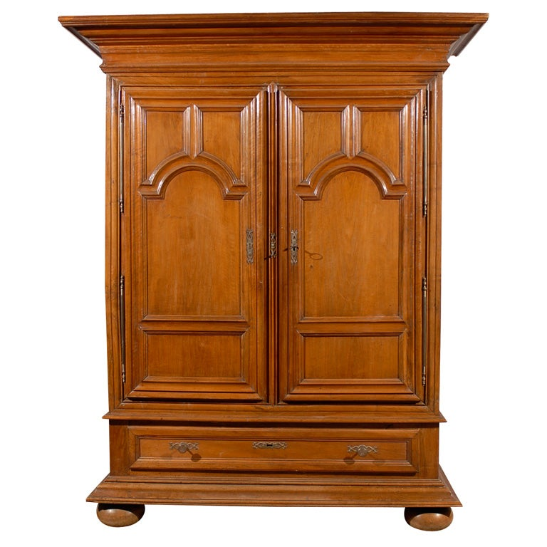 large 19th century cabinet in walnut with bun feet for