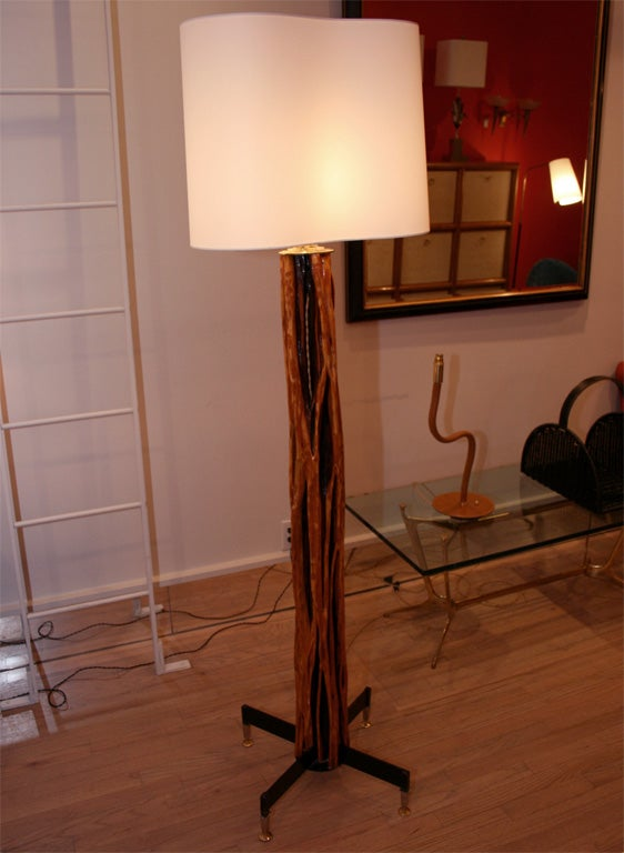 Fantastic floor lamp by J Adnet, the base is made of iron and brass, very neo classical, then the stem is a single piece of wood, apparently an exotic tree limb carved to fit the base.