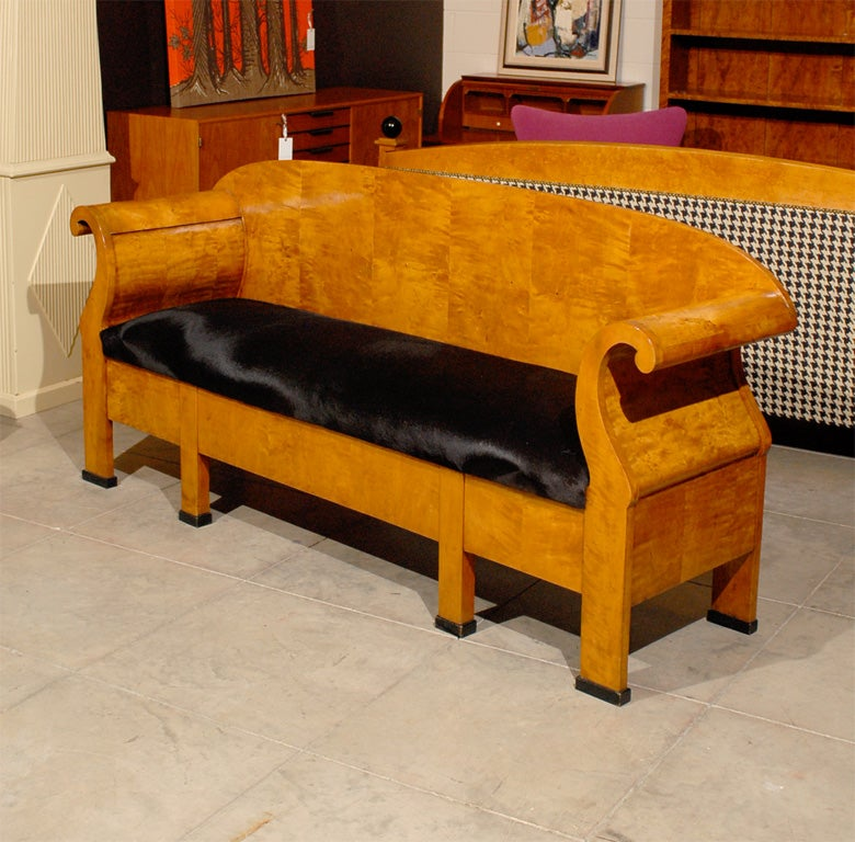 Rare antique Swedish Karl Johan settee/sofa in superb restored condition.  Hand-crafted of native golden flame birch and reupholstered in black hair cowhide leather, this settee is very comfortable according to modern standards.