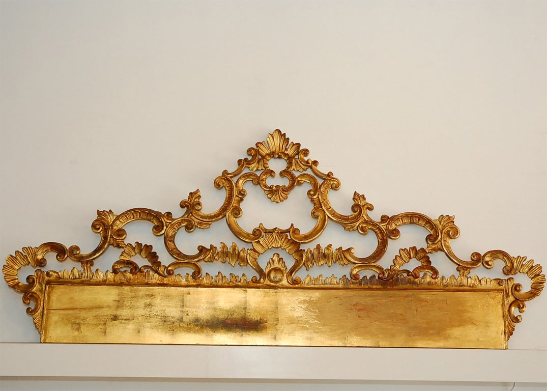 Expertly carved and gilded in the late 1940s by one of Florence's premier artigiani (artisans), after a piece in an 18th-century Florentine palace. The delicate woodwork is supported from behind by a network of hand-wrought iron reinforcements.<br