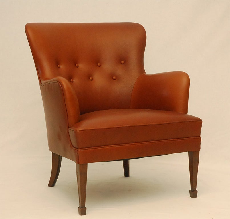 Frits Henningsen Brown Leather Arm Chair.  Store formerly known as ARTFUL DODGER INC