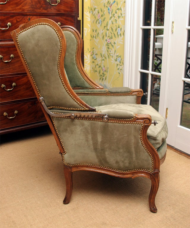 French Louis XV carved walnut reclining wing chair, c.1750 For Sale