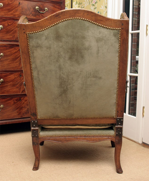 Walnut Louis XV carved walnut reclining wing chair, c.1750 For Sale