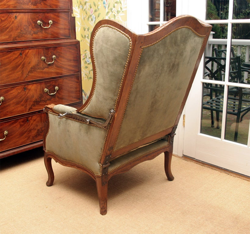 Louis XV carved walnut reclining wing chair, c.1750 For Sale 1