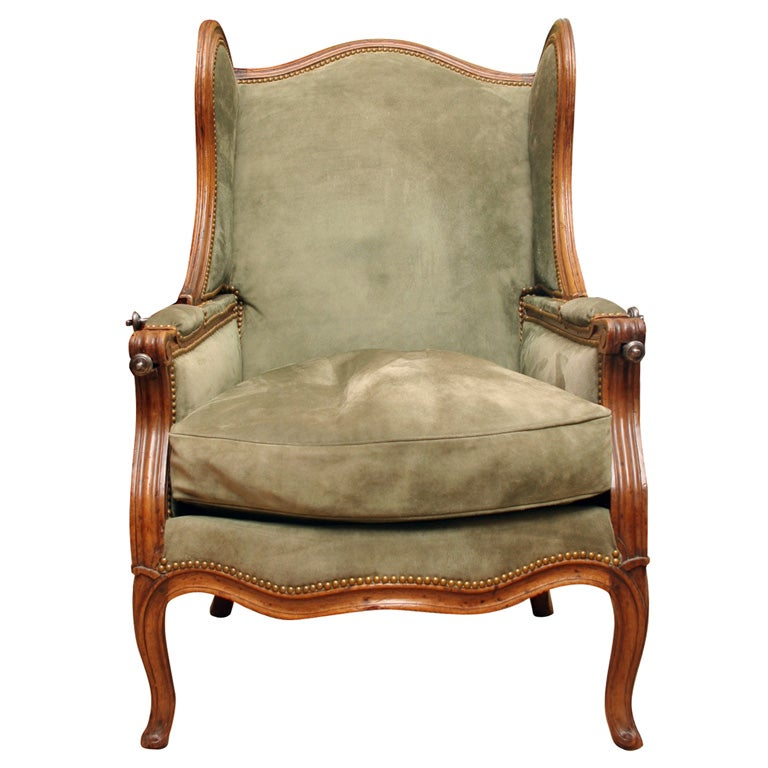 Louis XV carved walnut reclining wing chair, c.1750