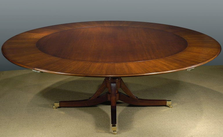 An Exceptional Hand Made Mahogany Round Dining Table With