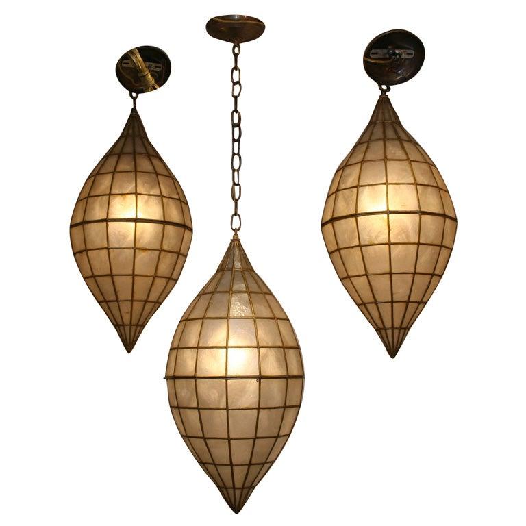 this elliptical form capiz shell pendant fixture is no longer. Black Bedroom Furniture Sets. Home Design Ideas