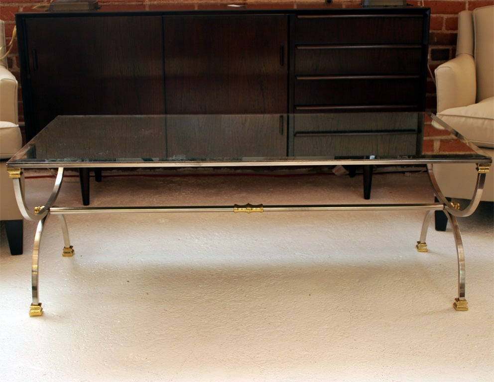 Mid-Century steel and brass coffee table with beveled mercury mirror top.