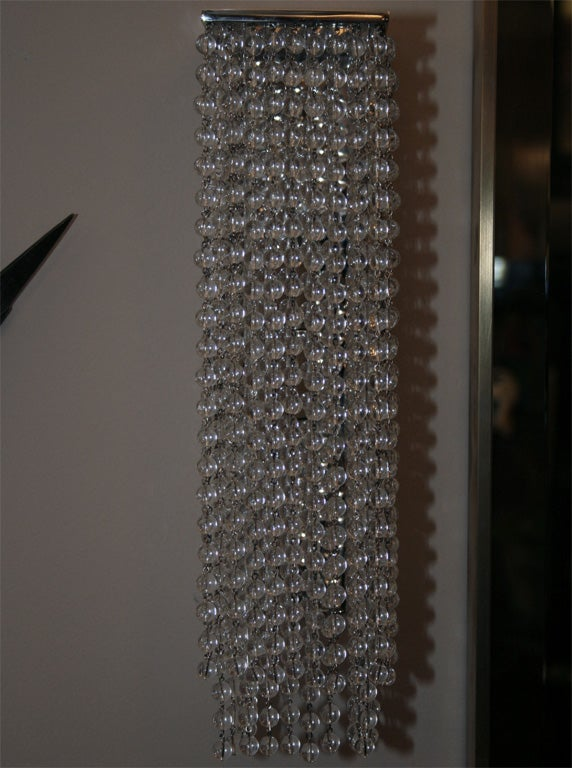 Pair of modern wall sconces in the Art Deco style, comprised of multiple glass beads rows hanging from a nickel-plated brass frame.