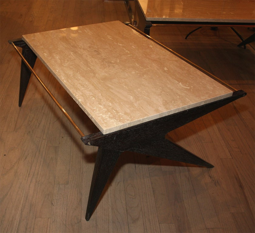 Elegant compass shaped oak tables with travertine tops.