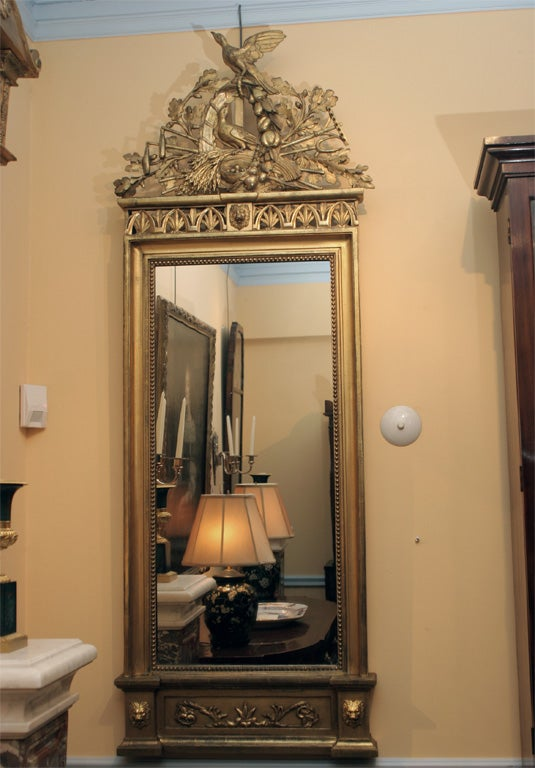 This mirror has carved details similar to a suite of seating furniture commissioned for the apartments of Maria Louisa of Bourbon, the Queen of Eturia. On view at the Palazzo Pitti in Florence. The suite of seat furniture was a royal commission made