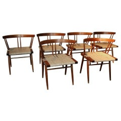 A set of Six and Eight Grass Seat Chairs by George Nakashima