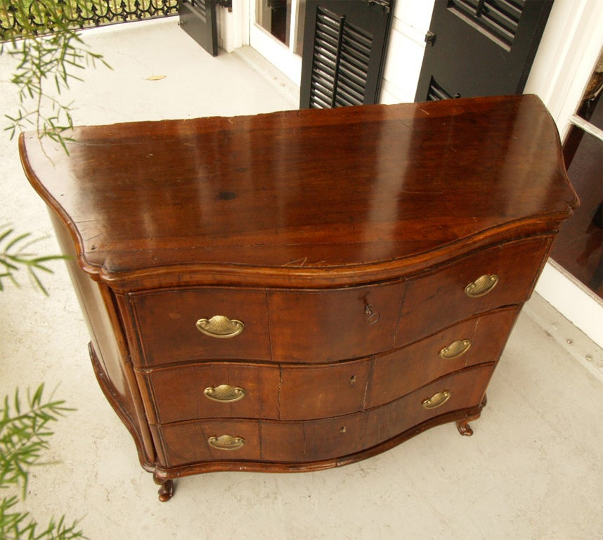 Early 18th c Italian Walnut Commode with wonderful movement.