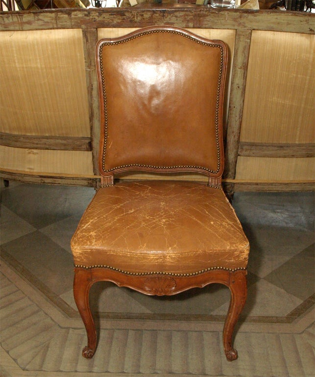 Set of six (6) Louis XV Style Dining Chairs.  Cherry wood upholstered in caramel leather in brass nails.