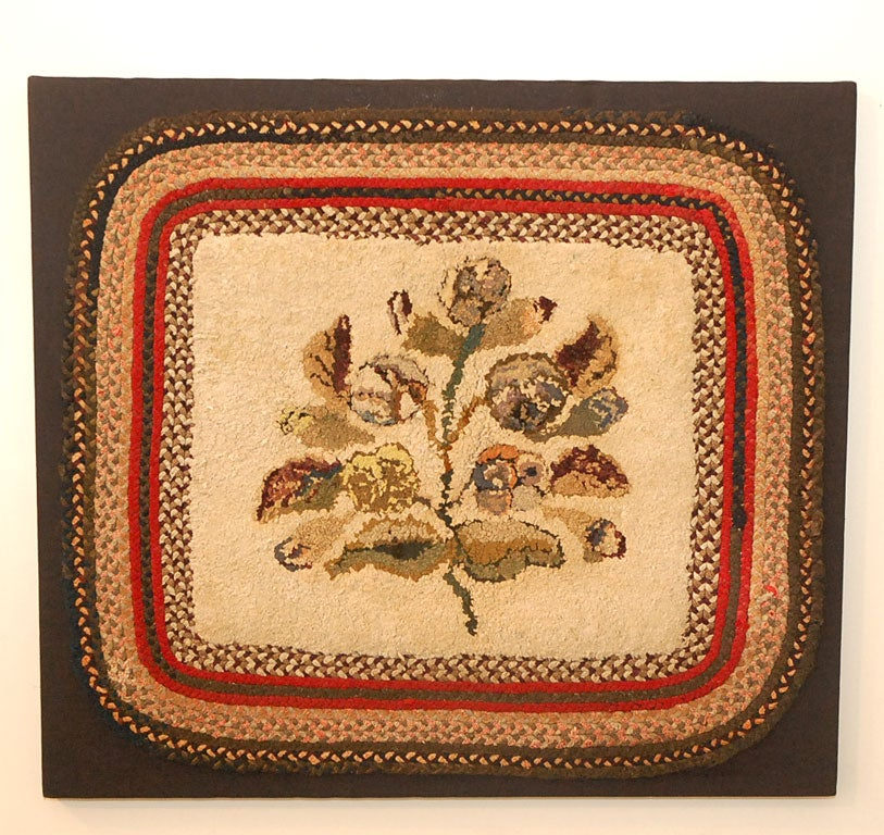 20TH C MOUNTED FOLKY FLORA HAND HOOKED RUG WITH BRAIDED