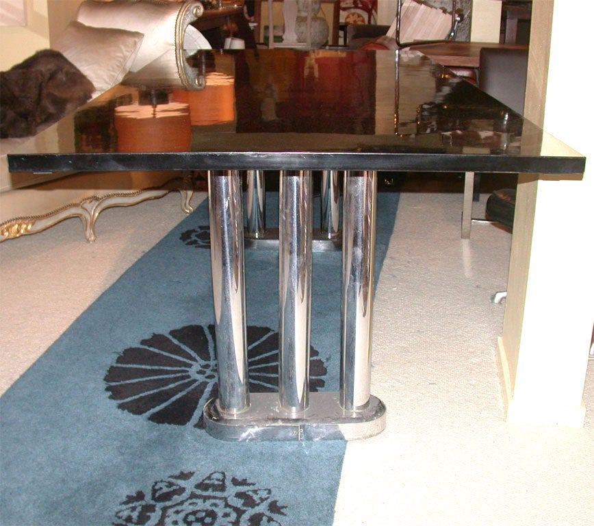 black lacquer dining table on double chrome pedestal base