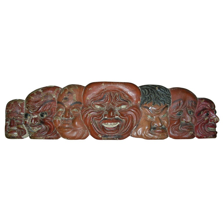 Th century japanese carved wood frieze of no masks at