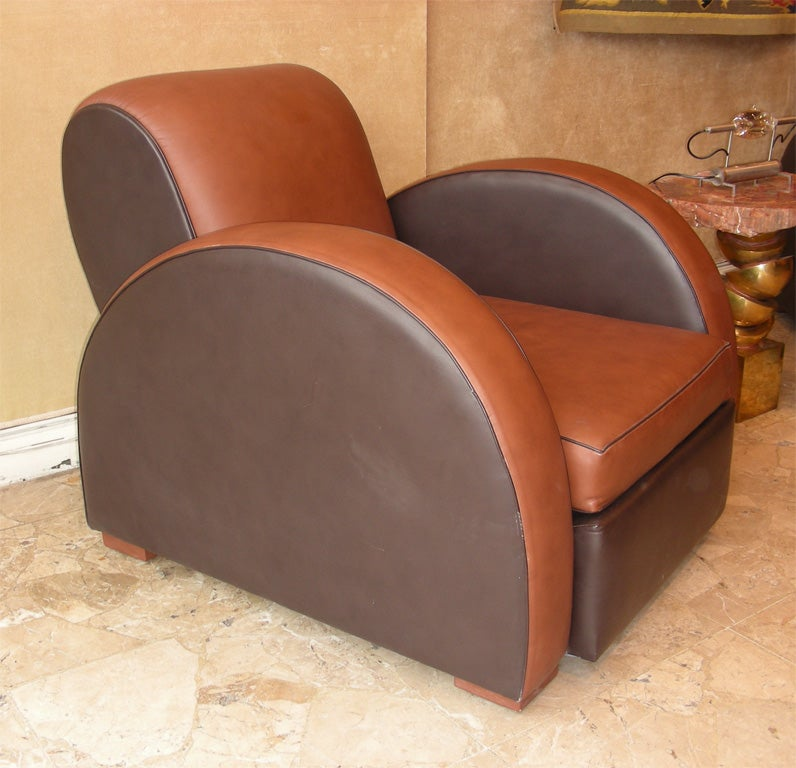 Two 1930s armchairs by Michel Duffet in wood and leather. Re-upholstered 5 years ago