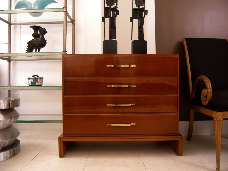 Tommi Parzinger for Charak Modern cherry chest with brass pulls.  In Stock.  Tommi (Anton) Parzinger (1903-1981) was born in Munich and received professional design training there at the Kunstgewebeschule (School of Arts and Crafts.)  He began his
