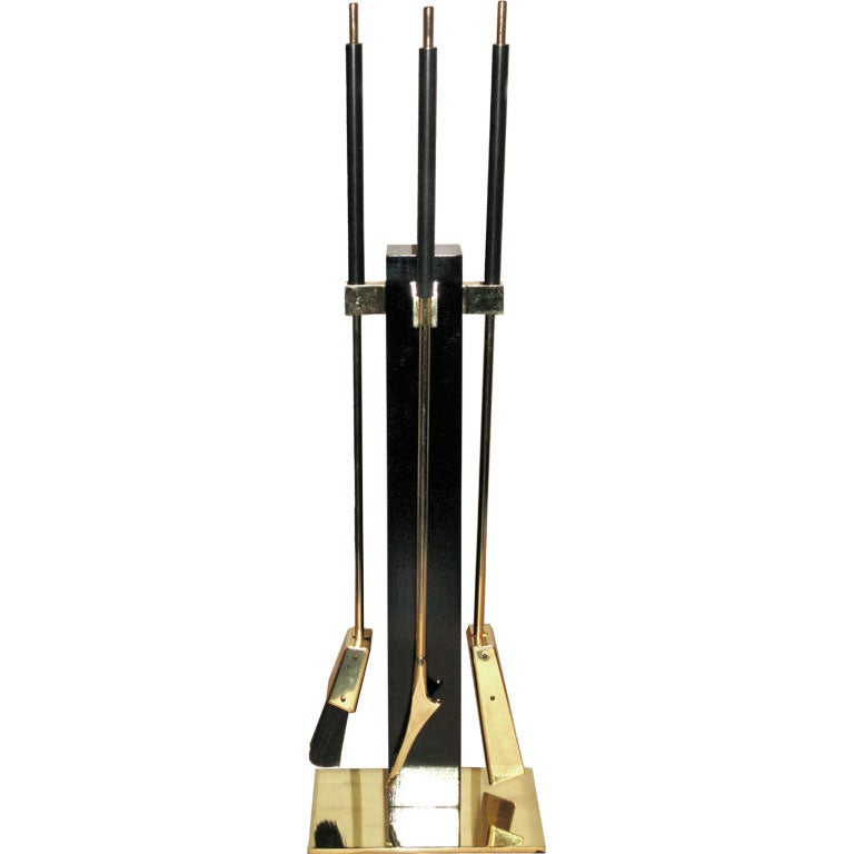 fireplace tool set in black lacquer and polished brass at