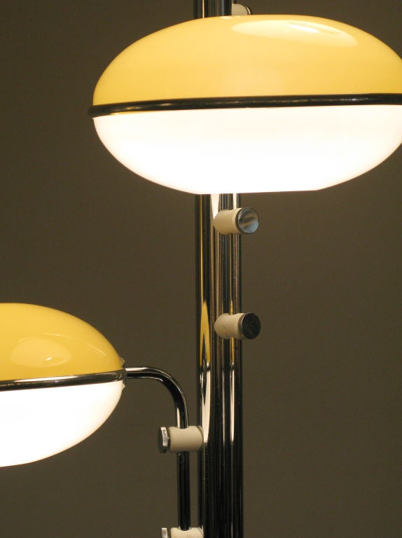 Triple Globe Floor Lamp With Yellow And White Shades At