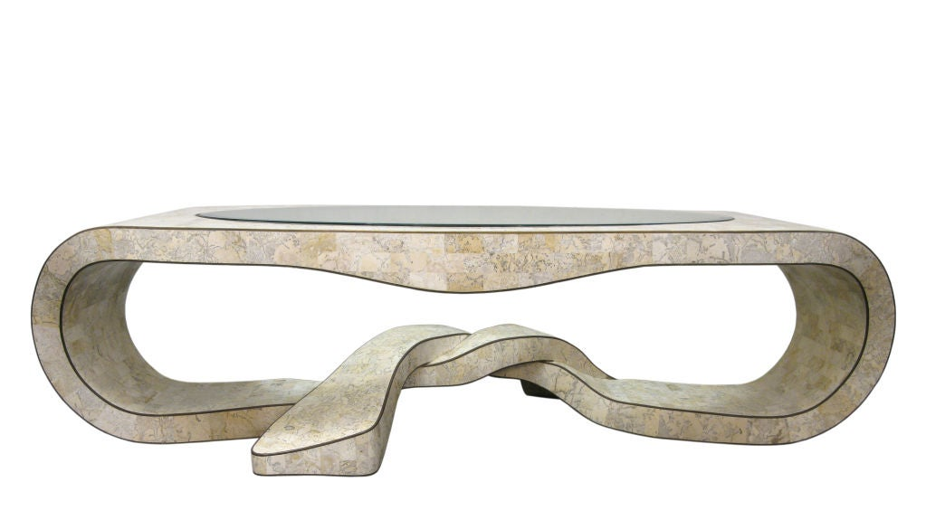 Sculptural coffee table in tessellated stone with brass inlays and inset glass top by Maitland Smith, 1970s (signed on bottom).