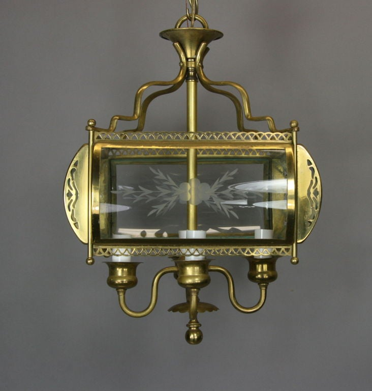 #1-2322, a four bent etched glass panels four-light brass lantern.  Three smaller versions available with two lights see 1-2390abc see last photo.  on sale regular price $1850 sale price $975 net.
