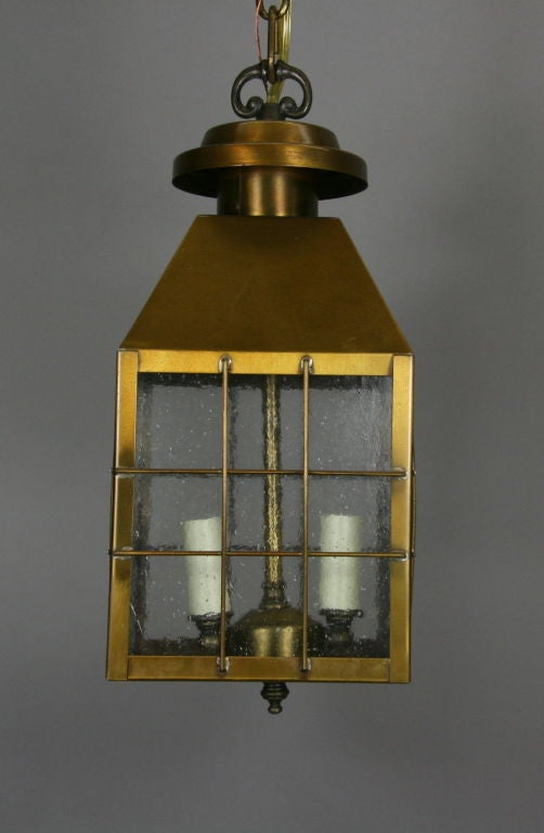 #1-2392ab, a brass lantern with four pebbled glass panels. Two light.