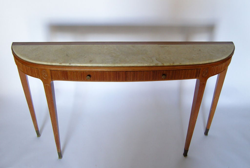 A fine Mid-Century Italian two drawer pearwood console with an onyx top and bronze sabots by Paolo Buffa.