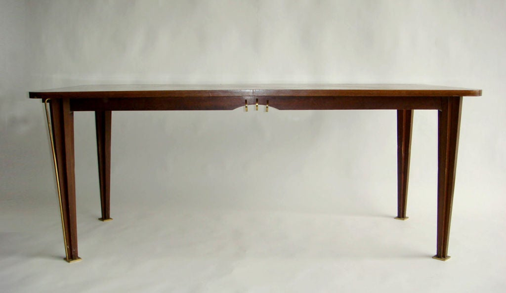 A fine French mid-century rosewood rectangular dining / writing table with rounded corners and refine bronze details. Possibility of 2 end extension leaves (to be made)