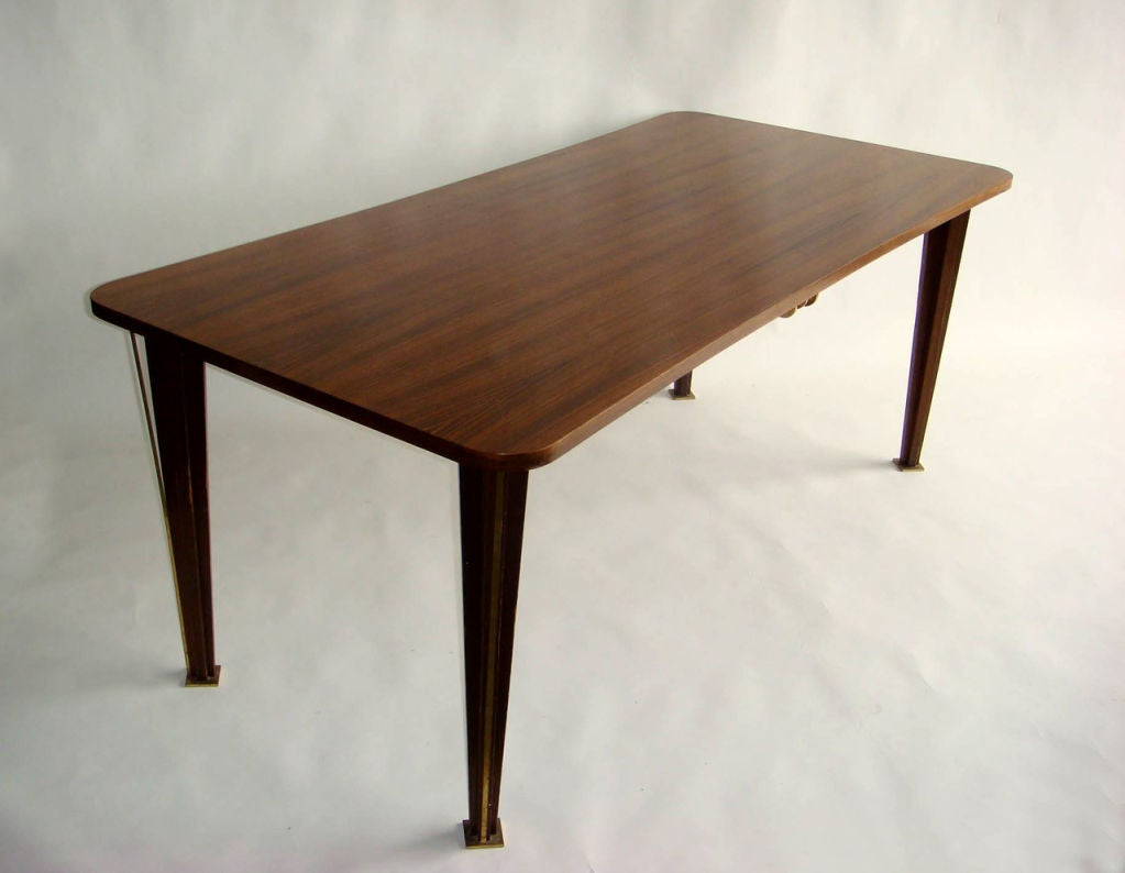 A Fine French 1950s Rosewood Dining Table In Good Condition For Sale In Long Island City, NY