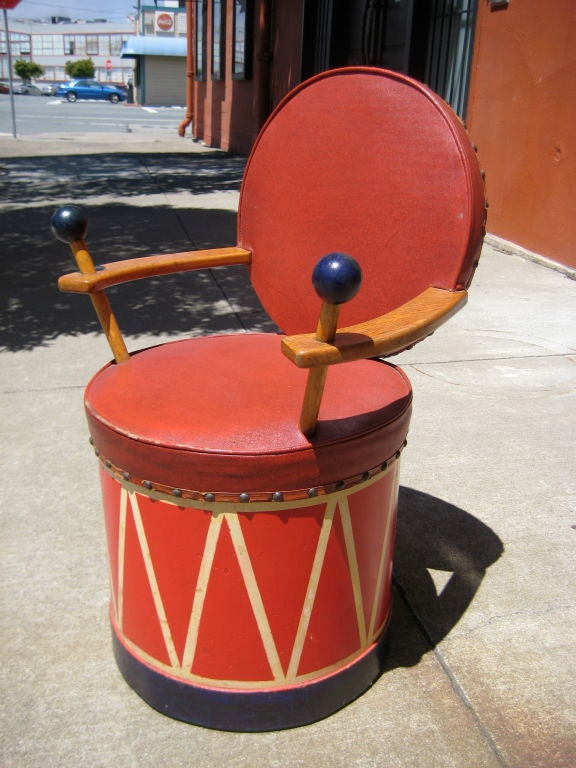 Exceptional child's chair fashioned for drum.