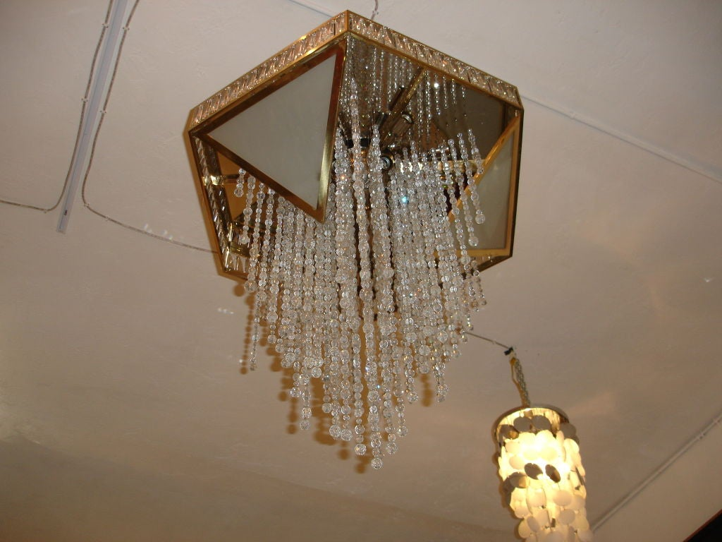French Chandelier Of Brass And Crystal At 1stdibs