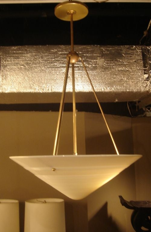 Milk glass and brass hanging light fixture.  French, circa 1950.  A French glass shade suspended from brass rods.    Glass shade measures 19
