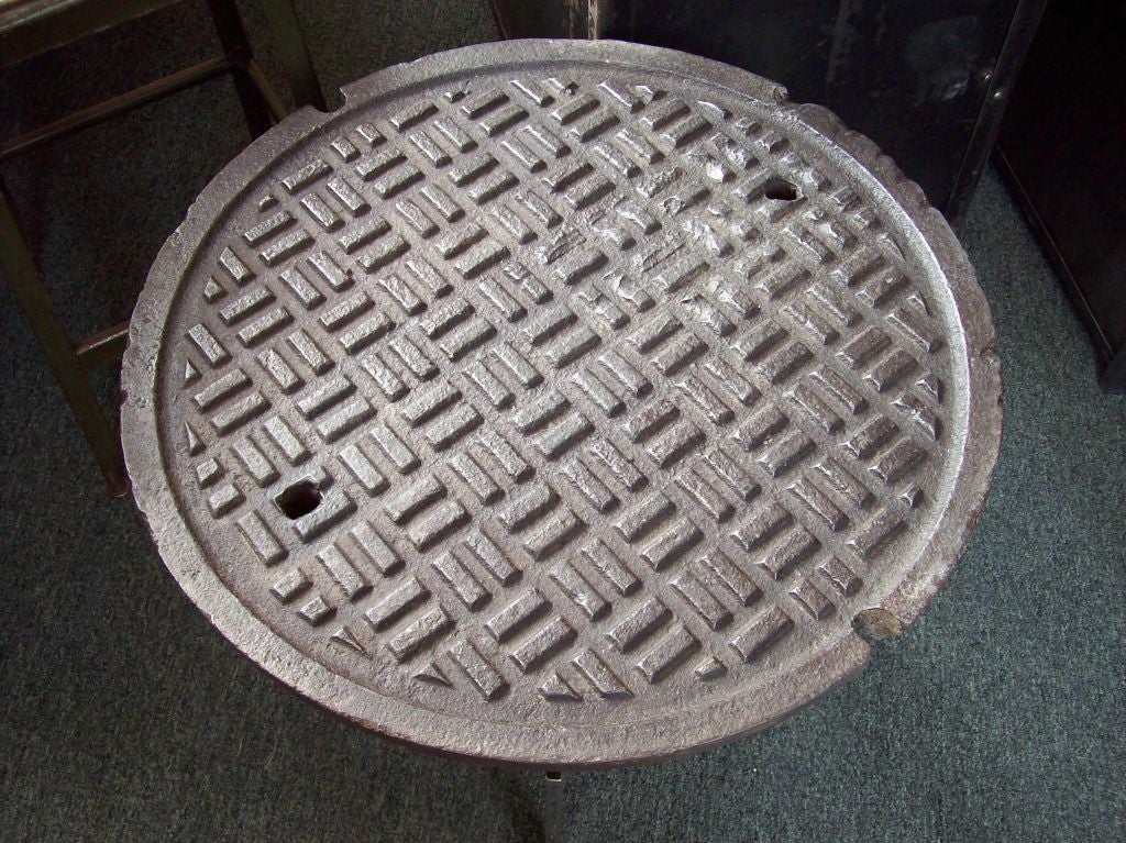 New York City Vintage Manhole Cover And Chrome Base End