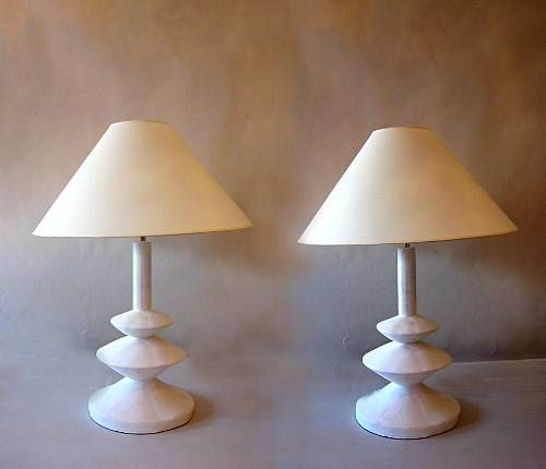 Sublime pair of French Mid-Century plaster table lamps by Jacques Grange Designed for Yves Saint Laurent Boutiques in France during the 1970s. Grange's inspiration was a model by Giacometti from the 1930s made for Jean-Michel Frank. The lamps