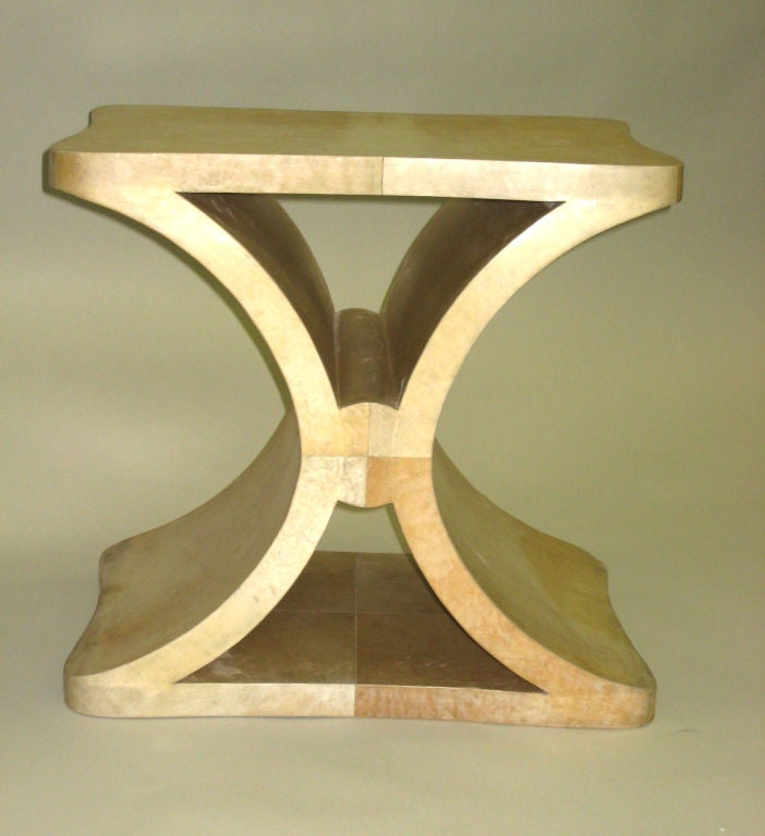 Chic French End table / Side table / bench in the modern neoclassical Spirit of Jean Michel Frank with a timeless X-frame form and covered in parchment.  Literature:  Similar Tables are displayed in the book Jean-Michel Frank, Paris, 2006. Karl