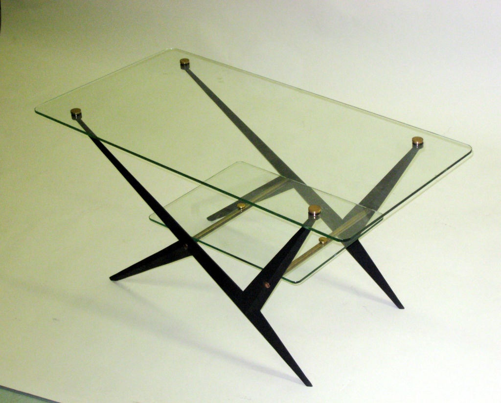 Chic pair of Italian Mid-Century Modern double level tables with panels of glass cantilevered over an angular enameled steel frame; glass is pierced and capped with round brass finials. Functioning as side / end tables or cocktail / coffee tables.