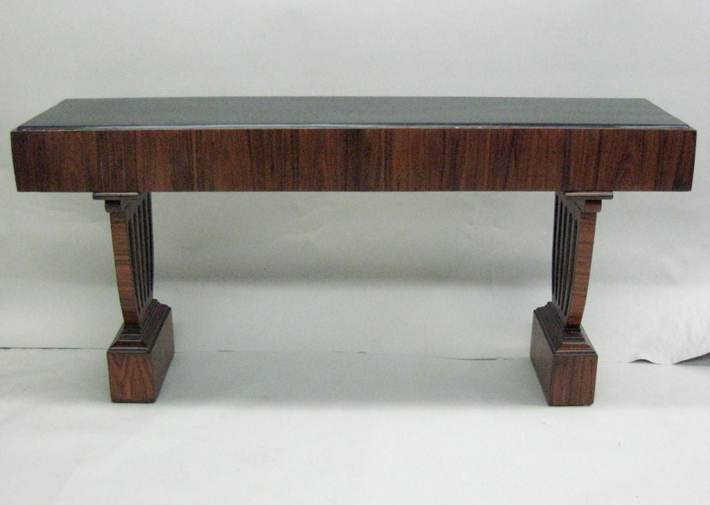 Large French, 1960s console / sofa table in the modern-neoclassical style featuring fluted pilaster style legs supporting a sober top.
