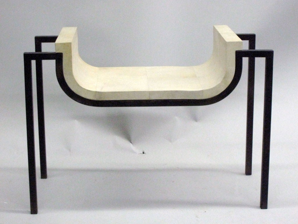 Elegant pair of Mid-Century style stools / benches with wrought iron frame and parchment seats exhibiting the influences of French Art Deco, modernism and a sober neoclassical spirit.  The ironwork, woodwork and parchment work on these pieces shows