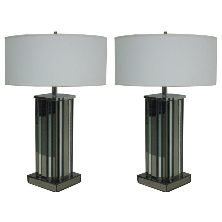 Pair of large Mid-Century Modern / Art Deco mirrored table lamps by Paul Frankl with alternating bands of silver and peach colored mirrored glass conveying the image of a skyscraper.