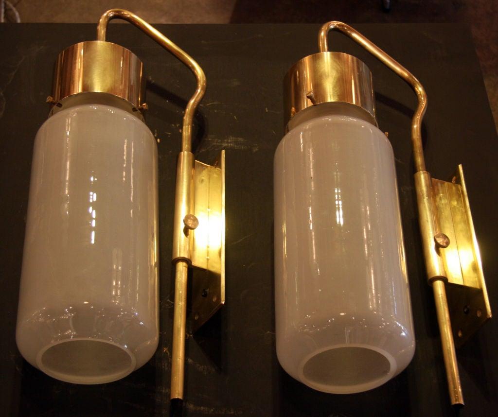 Beautiful fluid brass bracket with nice Italian milk glass shades & oversized to boot. CHICISSIMA!