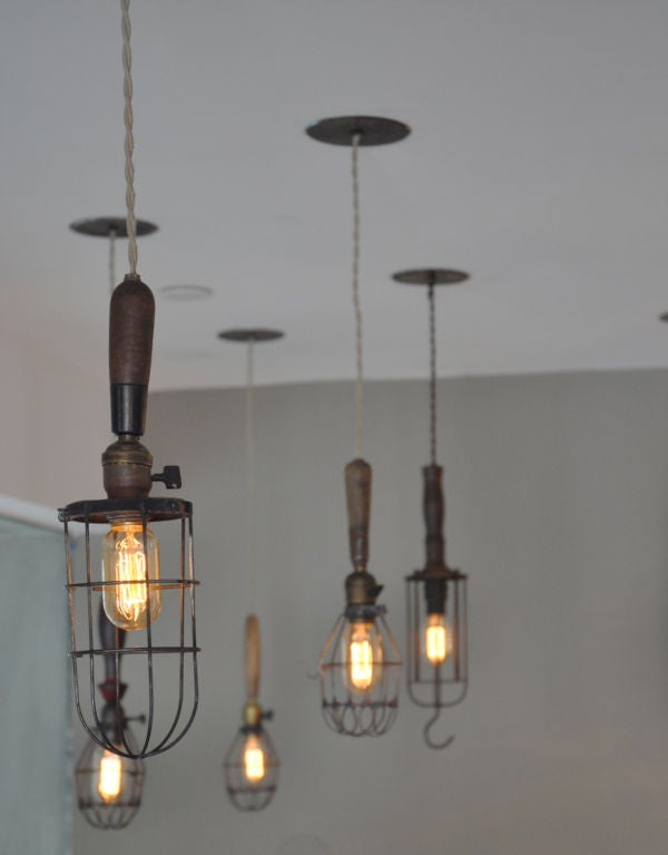 Industrial wire cage pendants with original sockets and wooden handles.  Sizes are from 16