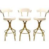 Three 1970s Brass Upholstered Bar Stools