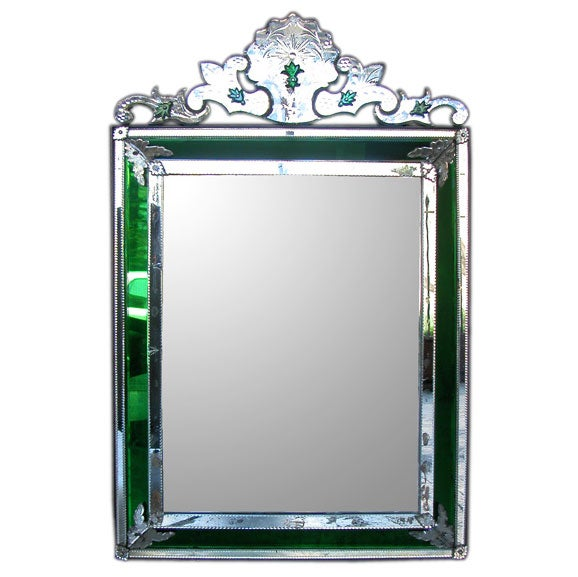 a shimmering venetian mirror with emerald green glass