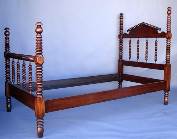 Custom bobbin bed with spool/bobbin head and foot board. Shown here in a twin size, in mahogany. Can be made in oak, mahogany, walnut or alder in a variety of sizes, full, queen king and California king. Headboards and footboards can be customizable