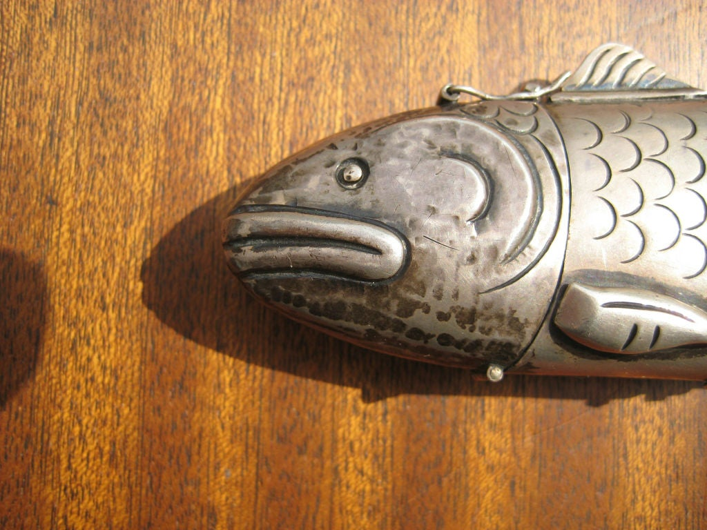 Beautiful handmade container in the shape of an articulating silver fish. Incredible craftsmanship; wonderful example of Spratling's Mexican Modern design sensibility. This design was included in the important 1965 traveling museum retrospective of