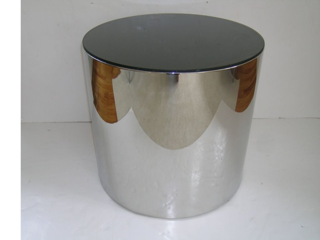 Canister end tables in heavy guage stainless and smoke glass.