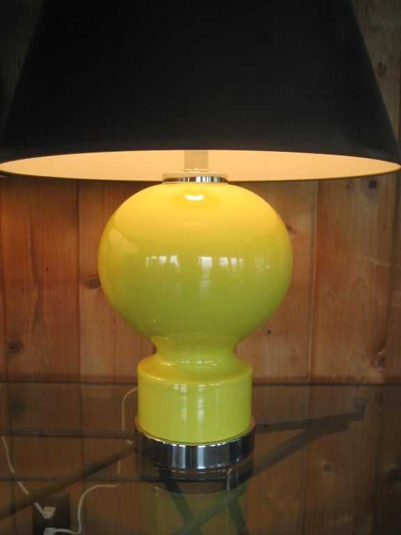 A great pair of yellow, ceramic, hour glass shaped lamps from the 1970's. Well made with chromed bases and heavy finials.
